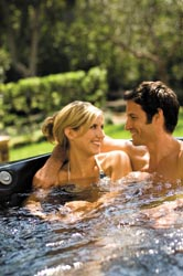 Discount hot tub spas just mean they are bought for less, but can still be of very high quality. Here a couple enjoys a discount hot tub.